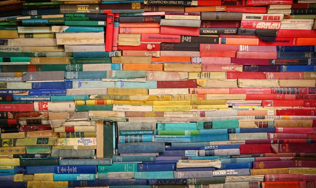 Colourful books stacked tightly